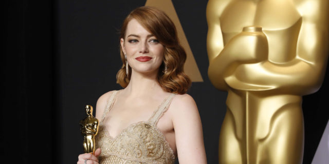 "89th Academy Awards - Oscars Backstage - Hollywood, California, U.S. - 26/02/17 - Emma Stone poses with her Oscar for Best Actress for her role in ""La La Land"". REUTERS/Lucas Jackson"